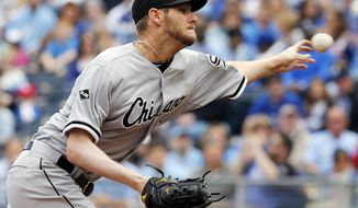 Chicago White Sox starting pitcher Chris Sale delivers to a Kansas City Royals batter during the first inning of a baseball game at Kauffman Stadium in Kansas City, Mo., Sunday, April 6, 2014. (AP Photo/Orlin Wagner)
