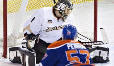 Anaheim Ducks goalie Jonas Hiller (1) is scored on by Edmonton Oilers David Perron (57) during second period NHL hockey action in Edmonton,  Alberta, on Sunday April 6, 2014. (AP Photo/The Canadian Press, Jason Franson)