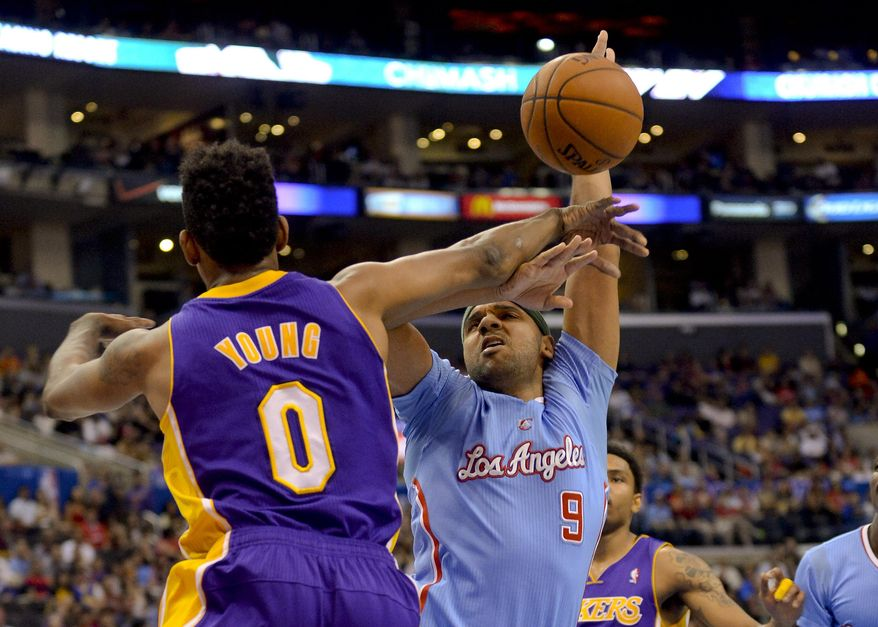 Los Angeles Lakers forward Nick Young (0) strips the ball from Los Angeles Clippers forward Jared Dudley (9) in the first half of an NBA basketball game on Sunday, April 6, 2014, in Los Angeles. (AP Photo/Gus Ruelas)