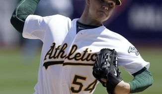 Oakland Athletics' Sonny Gray works against the Seattle Mariners in the first inning of a baseball game Sunday, April 6, 2014, in Oakland, Calif. (AP Photo/Ben Margot)