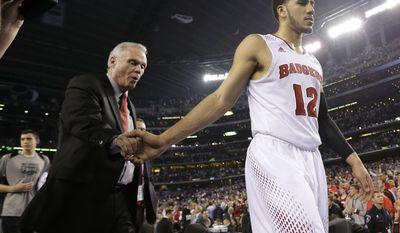 Wisconsin head coach Bo Ryan, left, and guard Traevon Jackson walk off the court after their 74-73 loss to Kentucky in an NCAA Final Four tournament college basketball semifinal game Saturday, April 5, 2014, in Arlington, Texas. (AP Photo/Eric Gay)