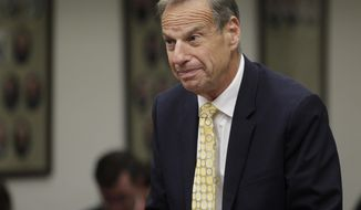 FILE - In this Dec. 9, 2013 file photo, former San Diego Mayor Bob Filner stands before judge Robert J. Trentacosta's courtroom as he was sentenced in San Diego. Filner's three-month house arrest ended Sunday,  April 6, 2014, fulfilling a sentence for felony false imprisonment and two misdemeanor charges of battery involving victims of sexual harassment, his lawyer Earll Pott told local media. San Diego's first Democratic leader in 20 years resigned in August after less than nine months in office amid a torrent of sexual harassment allegations from numerous women. (AP Photo/U-T San Diego,  John Gastaldo, Pool, File)