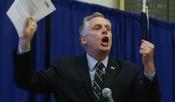 Virginia Governor Terry McAuliffe waves a letter from the Center for Medicare and Medicaid Services during a news conference at the Patrick Henry Building in Richmond, Va.,  Monday, March 24, 2014.  McAuliffe is proposing a two-year pilot of an expanded Medicaid program, a suggestion he hopes will persuade Republicans to end an impasse over the state's budget. McAuliffe announced that the federal government said it would not penalize Virginia if it ran a two-year pilot program.  House Republicans oppose Medicaid expansion. The federal government has promised to fund the bulk of the expansion. (AP Photo/Richmond Times-Dispatch, Bob Brown).
