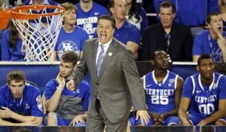 Kentucky head coach John Calipari works from the sideline against Wisconsin during the second half of the NCAA Final Four tournament college basketball semifinal game Saturday, April 5, 2014, in Arlington, Texas. Kentucky won 74-73. (AP Photo/Tony Gutierrez)