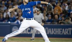 Toronto Blue Jays starting pitcher Drew Hutchison works against the New York Yankees during the first inning of a baseball game in Toronto on Sunday, April 6, 2014.  (AP Photo/The Canadian Press, Nathan Denette)