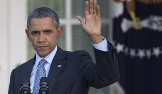 ** FILE ** In this April 1, 2014, photo, President Barack Obama, waves to the audience as he leaves the Rose Garden of the White House in Washington, Tuesday, April 1, 2014, after speaking about the Affordable Care Act. (AP Photo/Carolyn Kaster)