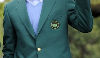 """The 2013 Masters champion Adam Scott, of Australia, waves to a crowd during a trophy presentation for the """"Drive, Chip and Putt"""" contest at Augusta National on Sunday, April 6, 2014, in Augusta, Ga. (AP Photo/The Augusta Chronicle, Rainier Ehrhardt)"""