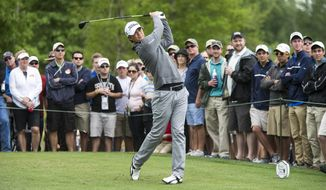 Matt Jones tees off on the 11th hole during the third round of the Houston Open golf tournament on Saturday, April 5, 2014, in Humble, Texas. (AP Photo/The Courier, Andrew Buckley)