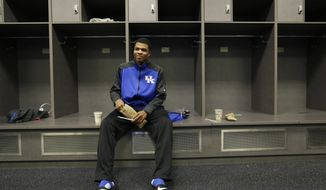 Kentucky guard Andrew Harrison waits for the start of practice for the NCAA Final Four tournament college basketball championship game Sunday, April 6, 2014, in Arlington, Texas. Kentucky plays Connecticut in the championship game on Monday, April 7. 2014. (AP Photo/Eric Gay)