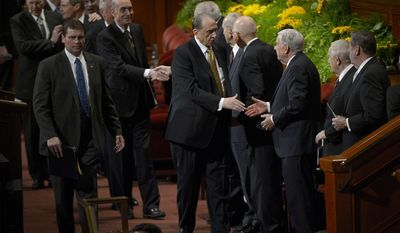 President Thomas S. Monson greets members of the Quorum of the Twelve as he leaves the morning session of the 184th General Conference of the Church of Jesus Christ of Latter Day Saints, Sunday, April 6, 2014 in Salt Lake City. (AP Photo/The Salt Lake Tribune, Scott Sommerdorf)