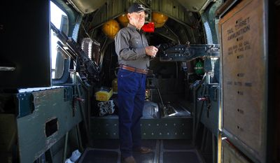 This March 31, 2014 photo shows Ludwig Havlak touring a B-24 Liberator parked on the tarmac at Skyline Aviation at Mathis Field in San Angelo, Texas. The last time Havlak, now 92, set foot on a B-24 was in April 1945 after finishing more than 40 missions as a crew member during World War II in the Pacific. (AP Photo/Standard-Times, Patrick Dove)