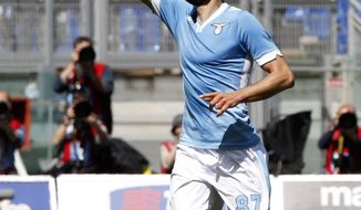 Lazio midfielder Antonio Candreva celebrates after scoring during a Serie A soccer match between Lazio and Sampdoria, at Rome's Olympic stadium, Sunday, April 6, 2014. (AP Photo/Riccardo De Luca)
