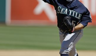 Seattle Mariners' Erasmo Ramirez works against the Oakland Athletics in the first inning of a baseball game Sunday, April 6, 2014, in Oakland, Calif. (AP Photo/Ben Margot)