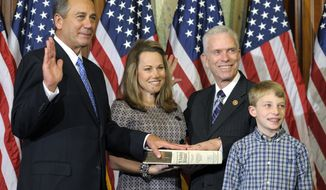 FILE-This Thursday, Jan, 3, 2013 file photo shows House Speaker John Boehner, left, left, performing a mock swearing in for Rep. Bill Johnson, R-Ohio, second from right, on Capitol Hill in Washington as the 113th Congress began. Ohio Democrats who hold a small minority in their congressional delegation are heading into the primary elections with basically nothing to lose and hoping to gain, but only if GOP missteps and Tea Party challenges help them along the way. (AP Photo/Cliff Owen, File)