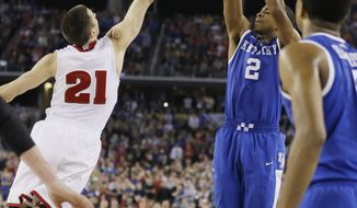 Kentucky guard Aaron Harrison (2) makes a three-point basket in the final seconds over Wisconsin guard Josh Gasser (21) to win the game 74-73 during their NCAA Final Four tournament college basketball semifinal game Saturday, April 5, 2014, in Arlington, Texas. (AP Photo/Charlie Neibergall)