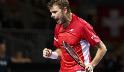 Stanislas Wawrinka, of Switzerland, reacts after winning a break game against to Mikhail Kukushkin, of Kazakhstan, during the third single match of the  tennis Davis Cup World Group quarterfinal  between Switzerland and Kazakhstan,  in Geneva, Switzerland, Sunday, April 6, 2014.  (AP Photo/Keystone,Salvatore Di Nolfi)