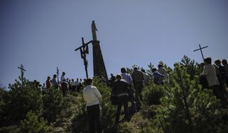 Devout Catholics take part in the Stations of the Cross of San Cristobal, in Artica northern Spain, Sunday, April 6, 2014. Spanish Catholics take part in several religious ceremonies, prior to the Holy week. (AP Photo / Alvaro Barrientos)