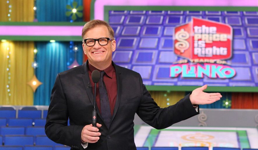 """** FILE ** This 2013 photo released by CBS shows Drew Carey, host of """"The Price is Right,"""" on the set in Los Angeles. (AP Photo/CBS, Cliff Lipson)"""