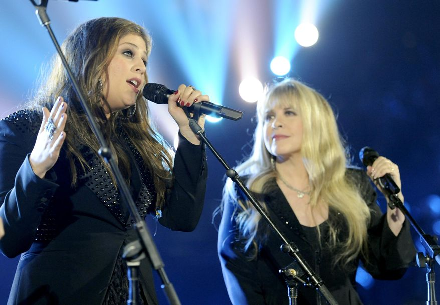 Hillary Scott, of the musical group Lady Antebellum, left, and Stevie Nicks perform on stage at the 49th annual Academy of Country Music Awards at the MGM Grand Garden Arena on Sunday, April 6, 2014, in Las Vegas. (Photo by Chris Pizzello/Invision/AP)