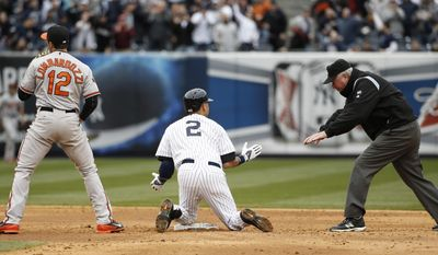Second base umpire Tim Welke calls New York Yankees' Derek Jeter (2) safe as Jeter and Baltimore Orioles second baseman Stephen Lombardozzi (12) react after Jeter ran out a double in the fifth inning of  the Yankees home opener baseball game against the Baltimore Orioles, at Yankee Stadium in New York, Monday, April 7, 2014. (AP Photo/Kathy Willens)
