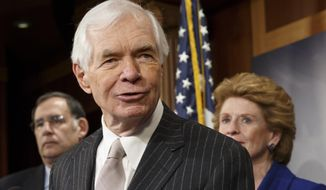 ** FILE ** This Feb. 4, 2014, file photo shows Sen. Thad Cochran, R-Miss, center, speaking during a news conference on Capitol Hill in Washington. (AP Photo/J. Scott Applewhite, File)