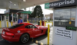 In this Wednesday, March, 26, 2014 photo, A rented 2013 Dodge Viper checks out at the Enterprise Exotic Car Collection showroom near Los Angeles International Airport. (AP Photo/Damian Dovarganes)