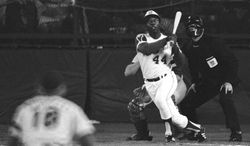 FILE - In this April 8, 1974 file photo, Atlanta Braves' Hank Aaron eyes the flight of the ball after hitting his 715th career homer in a game against the Los Angeles Dodgers in Atlanta. The 40th anniversary of Hank Aaron's 715th home run finds the Hall of Famer, now 80, coping with his recovery from hip surgery. The anniversary of his famous homer on April 8, 1974 will be celebrated before the Braves' home opener against the Mets on Tuesday night. (AP Photo/Harry Harrris, File)