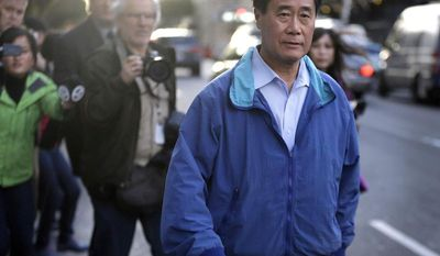 ** FILE ** In this March 26, 2014, file photo, California state Sen. Leland Yee, D-San Francisco, right, leaves the San Francisco Federal Building in San Francisco. (AP Photo/Ben Margot, File)