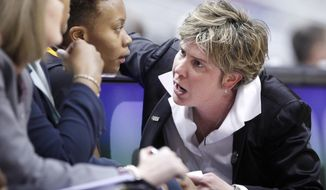 Virginia Commonwealth University Head Coach Marlene Stollings talks with Keira Robinson during the A-10 quarter-finals game against Dayton in Richmond, Va., Friday, March 7, 2014. The University of Minnesota Monday April 7, 2014, named Stollings their women's basketball coach.     (AP Photo/Richmond Times-Dispatch, Alexa Welch Edlund)