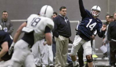 Penn State quarterback Christian Hackenberg throws to tight end Jesse James during an NCAA college spring football practice Saturday, April 5, 2014, State College, Pa. (AP Photo/PennLive.com, Joe Hermitt)