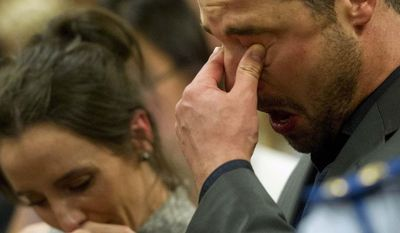 Carl Pistorius, right, listens to his brother Oscar Pistorius giving evidence in his murder trial in court in Pretoria, South Africa, Monday, April 7, 2014. Pistorius is charged with murder  for the shooting death of his girlfriend Reeva Steenkamp, on Valentines Day 2013. (AP Photo/Deaan Vivier, Pool)