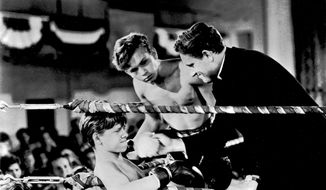 "FILE - This file image shows Mickey Rooney, left, Spencer Tracy, right, and Frankie Thomas in a scene from the 1938 film ""Boys Town."" Rooney, a Hollywood legend whose career spanned more than 80 years, died Sunday, April 6, 2014, at his North Hollywood, Calif. home. He was 93. (AP Photo/File)"