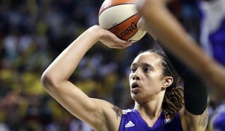 "FILE - In this June 2, 2013, file photo, Phoenix Mercury's Brittney Griner in action against the Seattle Storm in the second half of a WNBA basketball game in Seattle. Griner's busy WNBA offseason included competing in China, her first vacation in Miami and courtside seats to watch favorite player LeBron James. The slam-dunking Griner can add published author to her list of achievements with ""In My Skin,"" which chronicles her love of basketball and struggles with bullying, sexuality and family acceptance. (AP Photo/Elaine Thompson, File)"