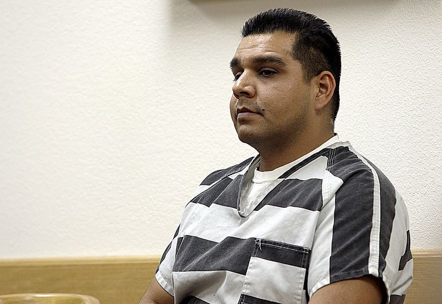 **FILE** Former West Sacramento police officer Sergio Alvarez appears in Yolo County Superior Court for his arraignment in Woodland, Calif., on Feb. 27, 2013. Alvarez is in jail after being indicted on suspicion of sexually assaulting six women while on duty in West Sacramento. (Associated Press/Woodland Daily Democrat, Deo Ferrer)