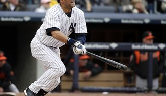 New York Yankees' Derek Jeter hits into a third-inning, run-scoring double play in a baseball game during the Yankees home opener against the Baltimore Orioles, at Yankee Stadium in New York, Monday, April 7, 2014.  (AP Photo/Kathy Willens)