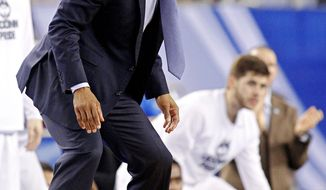 Connecticut head coach Kevin Ollie yells at players during the first half of their NCAA Final Four championship game against the Kentucky Wildcats Monday, April 7, 2014 at AT&T Stadium in Arlington, Texas. (AP Photo/The Dallas Morning News, Tom Fox)