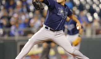 Tampa Bay Rays starting pitcher Matt Moore delivers to a Kansas City Royals batter during the third inning of a baseball game at Kauffman Stadium in Kansas City, Mo., Monday, April 7, 2014. (AP Photo/Orlin Wagner)