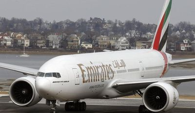 An Emirates Airlines Boeing 777 arrives at Logan International Airport in Boston, Monday, March 10, 2014. Emirates Airlines launched daily service between Boston and Dubai on Monday afternoon. (AP Photo/Michael Dwyer)