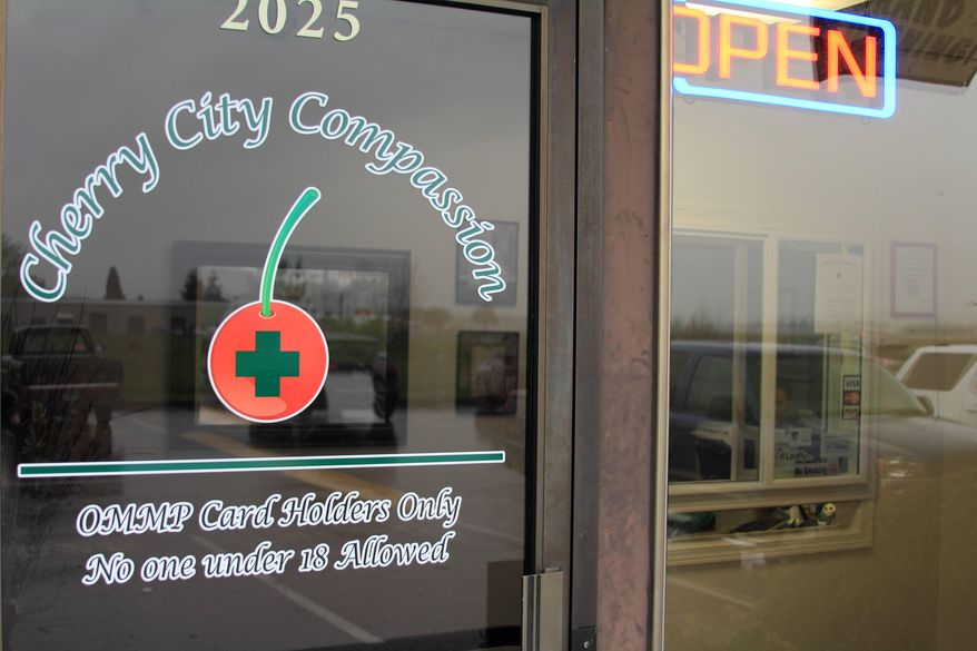 This photo taken March 28, 2014 shows Cherry City Compassion, a medical marijuana store in Salem, Ore. Until now, medical pot shops have operated in a gray area. That's changed under a law passed last year that legalizes medical marijuana dispensaries so long as they apply for and are granted a license. (AP Photo/Chad Garland)