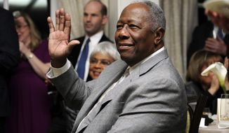 FILE - In this  Feb. 7, 2014 file photo, baseball Hall of Famer Hank Aaron waves during a reception in his honor in Washington. The 40th anniversary of Hank Aaron's 715th home run finds the Hall of Famer, now 80, coping with his recovery from hip surgery. The anniversary of his famous homer on April 8, 1974 will be celebrated before the Braves' home opener against the Mets on Tuesday night. (AP Photo/Nick Wass, File)