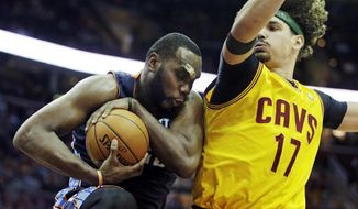 Charlotte Bobcats' Al Jefferson, left, controls a rebound against Cleveland Cavaliers' Anderson Varejao (17), from Brazil, in the fourth quarter of an NBA basketball game on Saturday, April 5, 2014, in Cleveland. Jefferson scored 24 points in the Bobcats' 96-94 overtime win. (AP Photo/Mark Duncan)