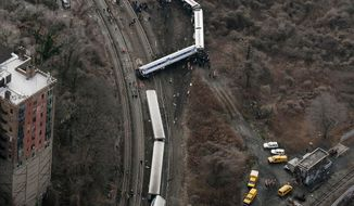 "FILE - In this Dec. 1, 2013 file photo, a Metro-North passenger train lays on it's side after derailing on a curved section of track  in the Bronx borough of New York. Federal investigators say William Rockefeller, who was engineer on a New York commuter train that derailed last year, killing four people, has a serious sleep disorder. A medical document made available Monday April 7, 2014, by the National Transportation Safety Board says he has ""severe obstructive sleep apnea."" The NTSB did not say whether the engineer's disorder contributed to the crash.( (AP Photo/Mark Lennihan, File)"