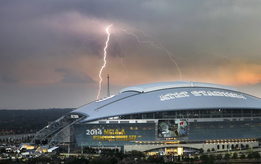 A lightning bolts strike from a passing thunderstorm in the distance behind AT&T Stadium in Arlington, Texas, site of the NCAA men's college basketball tournament Final Four, Thursday, April 3, 2014. (AP Photo/The Dallas Morning News, Tom Fox) MANDATORY CREDIT; MAGS OUT; TV OUT; INTERNET USE BY AP MEMBERS ONLY; NO SALES
