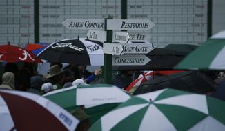 Spectators leave the Augusta National Golf Course after the first practice round for was suspended because of inclement weather at the Masters golf tournament Monday, April 7, 2014, in Augusta, Ga. (AP Photo/Matt Slocum)