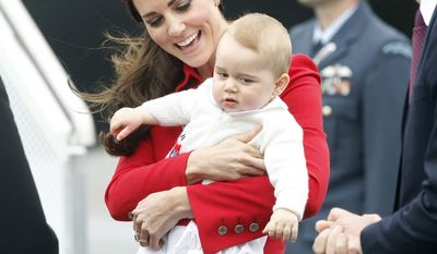 Britain's Catherine, Duchess of Cambridge, holds Prince George as Prince William, right, looks on during their arrival Monday, April 7, 2014, at Wellington Airport, New Zealand.  (AP Photo/New Zealand Herald, Mark Mitchell) NEW ZEALAND OUT, AUSTRALIA OUT