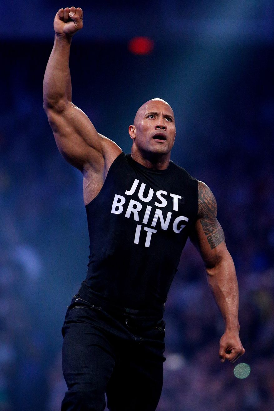 Dwayne Johnson aka The Rock is seen during Wrestlemania XXX at the Mercedes-Benz Super Dome in New Orleans on Sunday, April 6, 2014. (Jonathan Bachman/AP Images for WWE)