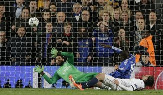 Chelsea's Demba Ba, in blue right, score his sides second goal of the game  during the Champions League quarterfinal second leg soccer match between Chelsea and Paris Saint Germain at Stamford Bridge stadium in London, Tuesday, April 8, 2014. (AP Photo/Matt Dunham).