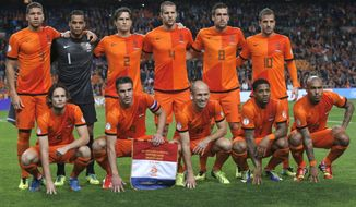 FILE - In this Oct. 11, 2013 file photo, Dutch soccer team poses prior the start the Group D World Cup qualifying soccer match between Netherlands and Hungary, at Arena stadium in Amsterdam, Netherlands. Background from left: Jeffrey Bruma, Michel Vorm, Daryl Janmaat, Ron Vlaar, Kevin Strootman, and Rafael van der Vaart. Foreground from left: Daley Blind, Robin van Persie, Arjen Robben, Jeremain Lens and Nigel de Jong.  (AP Photo/Peter Dejong, File)