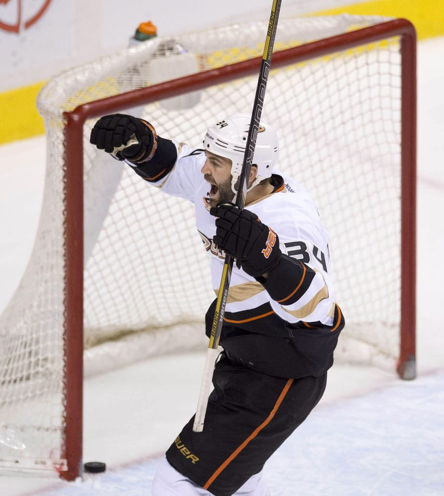 Anaheim Ducks right wing Daniel Winnik (34) celebrates teammate Kyle Palmieri's goal during the second period of NHL action against the Vancouver Canucks in Vancouver on Monday, April 7, 2014. (AP Photo/The Canadian Press, Jonathan Hayward)