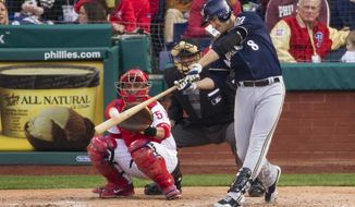 Milwaukee Brewers' Ryan Braun hits a solo home run in front of Philadelphia Phillies catcher Carlos Ruiz (51) during the fourth inning of a baseball game, Tuesday, April 8, 2014, in Philadelphia. (AP Photo/Chris Szagola)